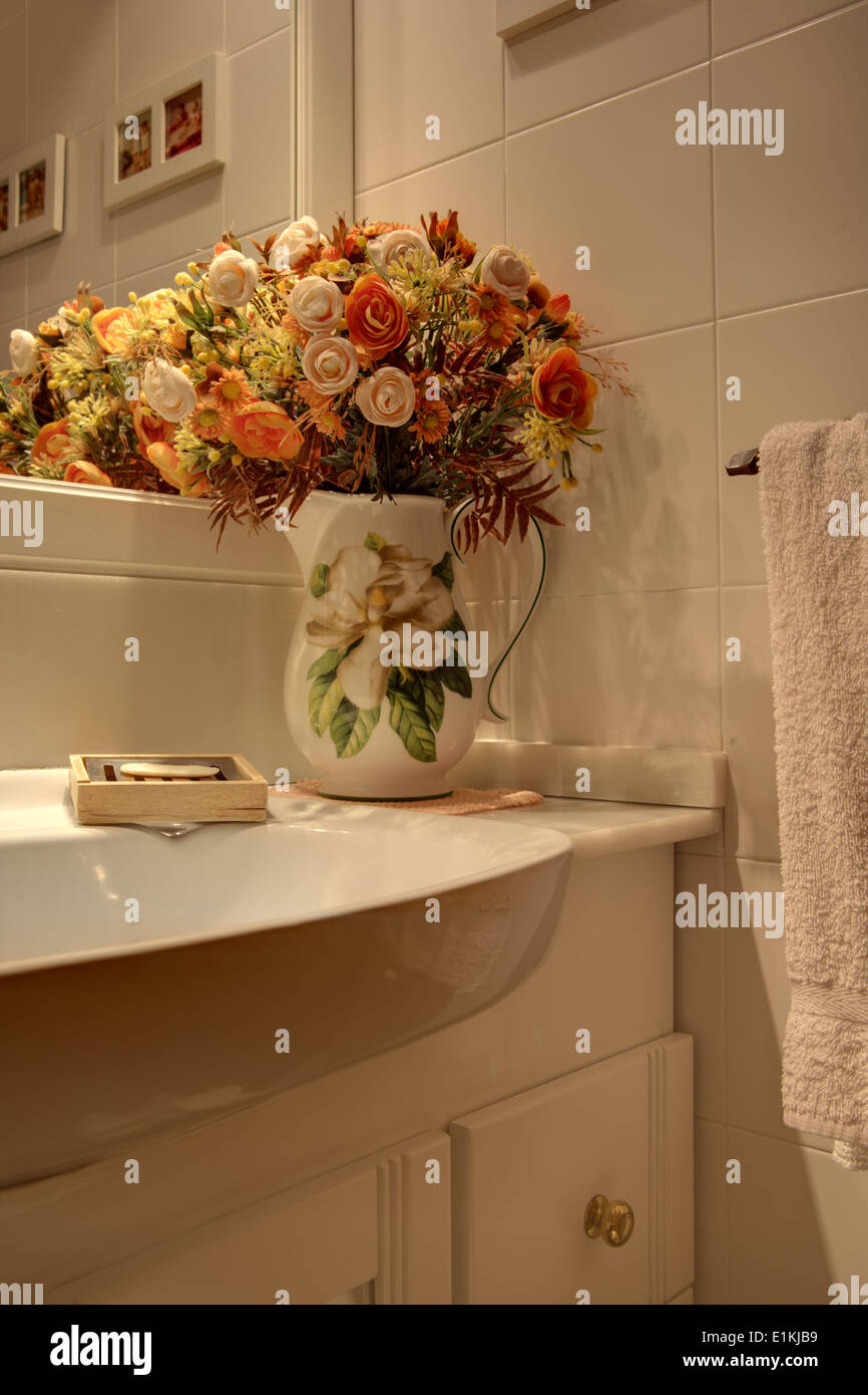 Vase with dried flowers decor in bathroom Spain Stock Photo