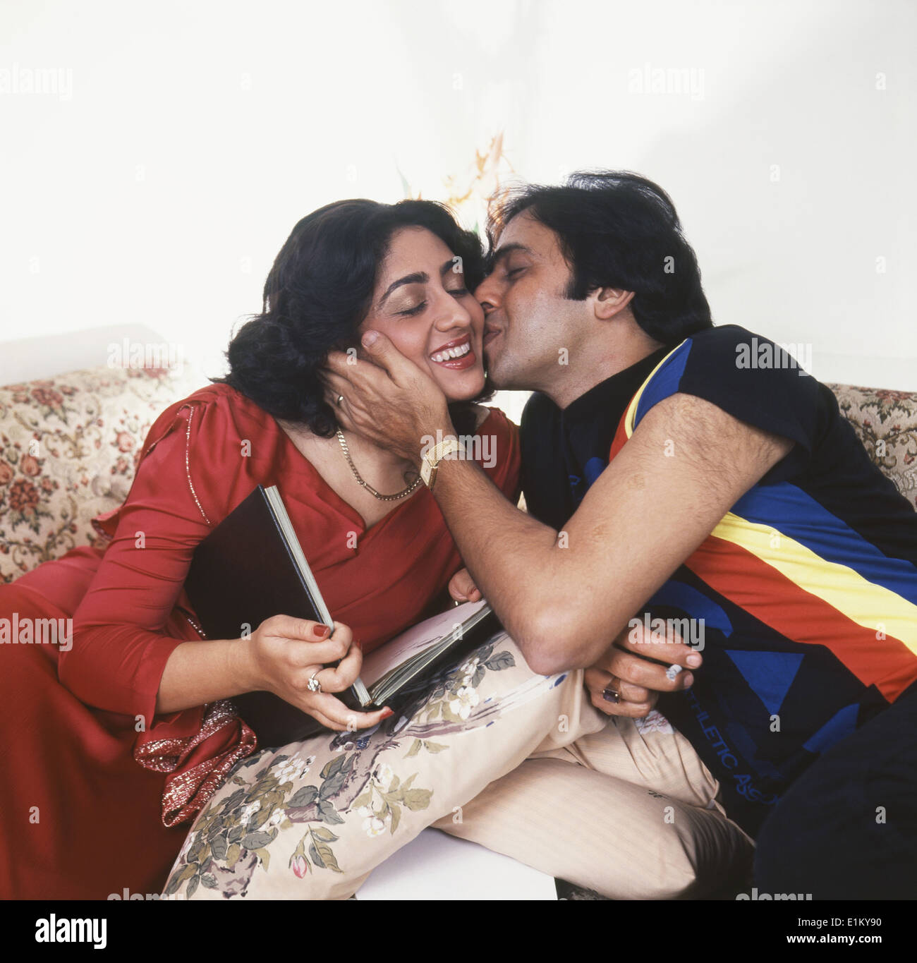 Portrait Of Indian Film Actor Vinod Mehra Kissing Actress Bindiya Goswami