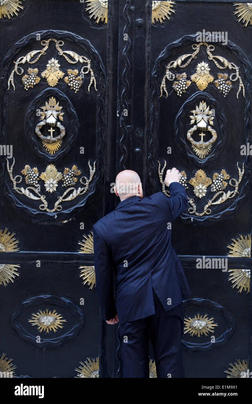 Guard closing the door of Uc Horan Armenian church & Guard closing the door of Uc Horan Armenian church Stock Photo ...