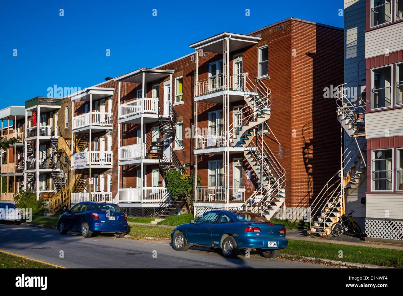 Three story apartment blocks on a street in shawinigan quebec canada