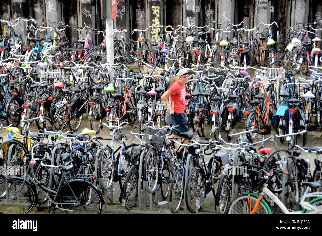 bicycles on bike stands outside amsterdam central railway. Black Bedroom Furniture Sets. Home Design Ideas