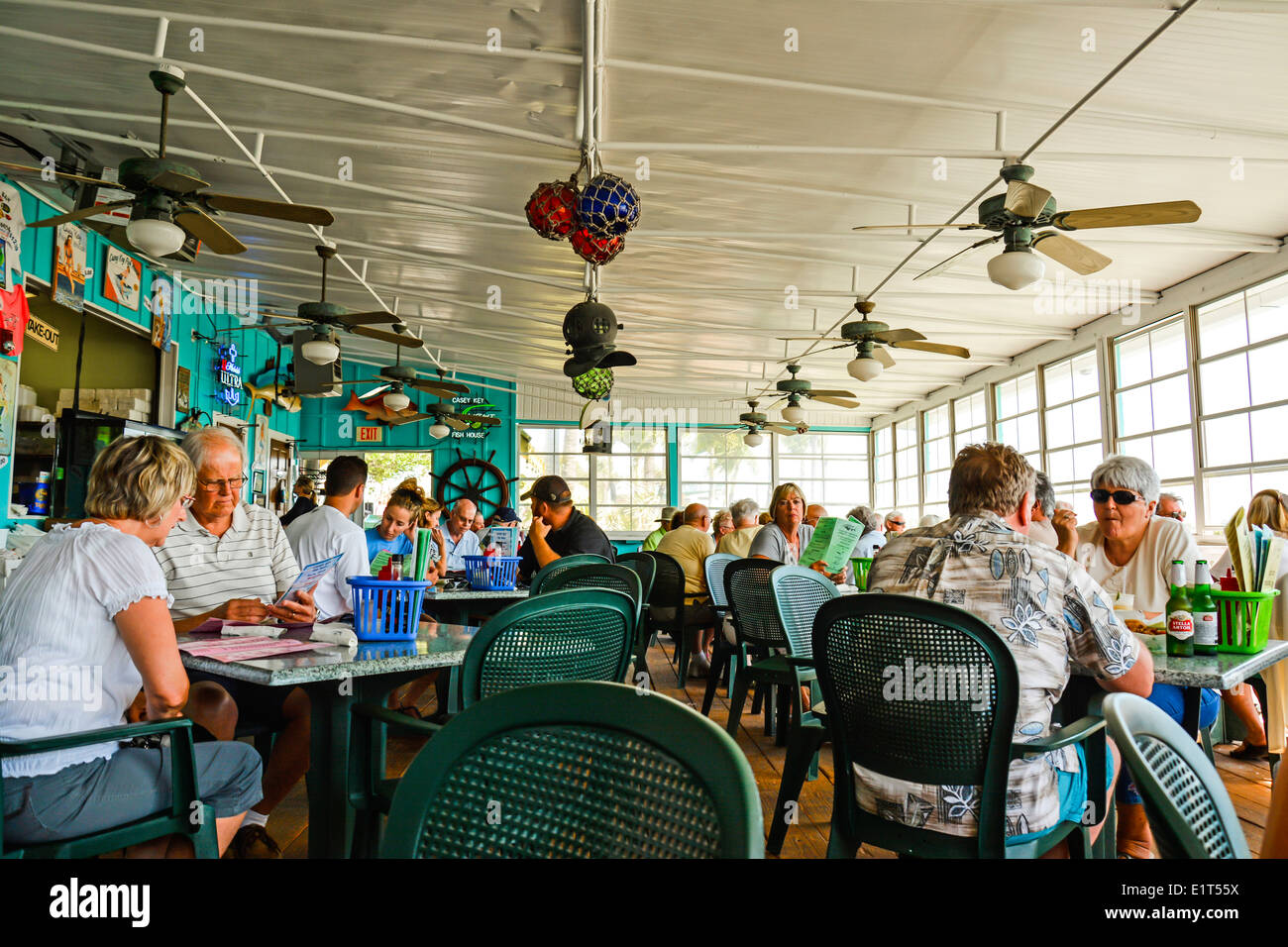 Patrons enjoying lunch at the waterfront themed casey key for Casey key fish house