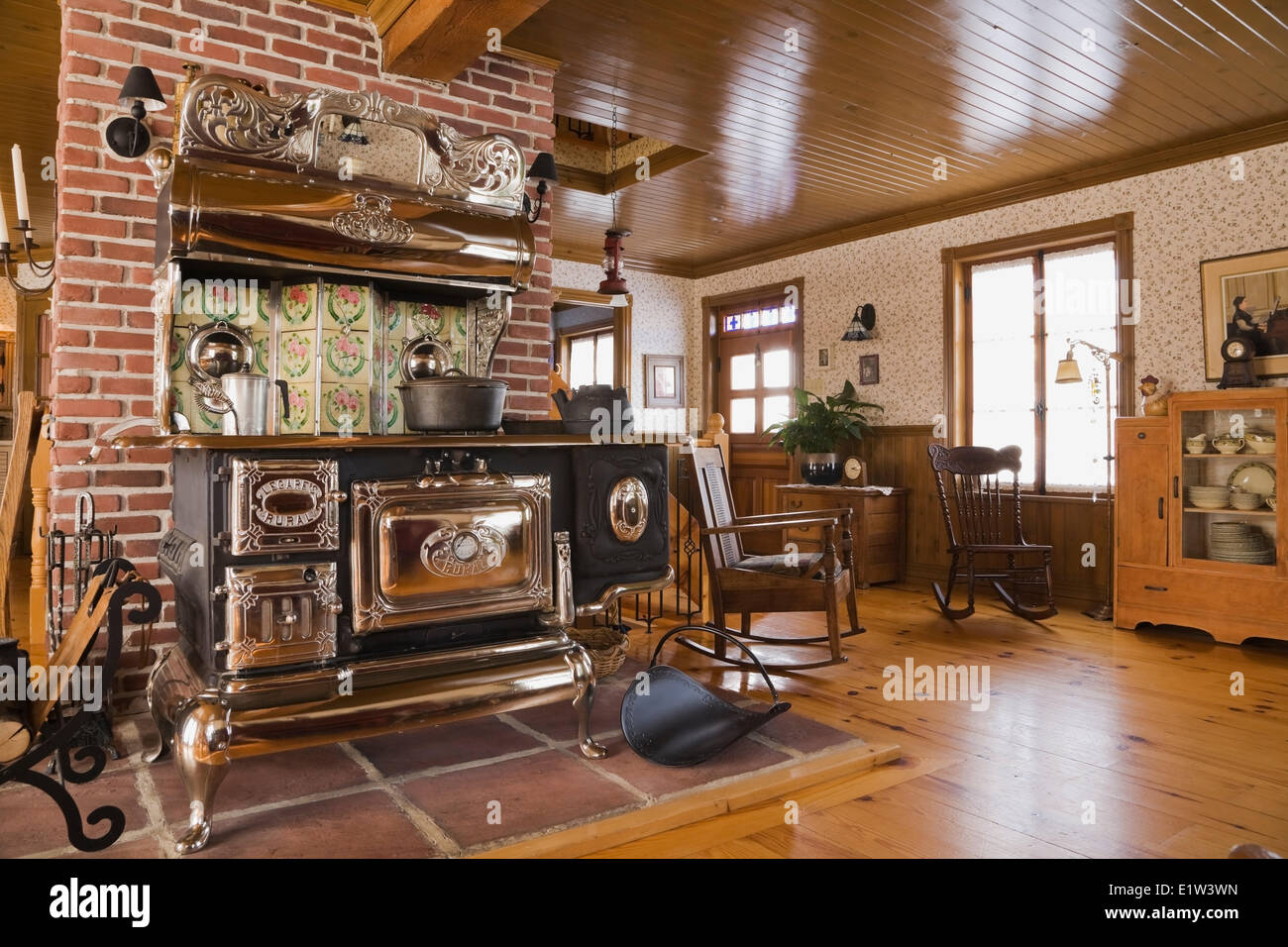 Old Legare's Rural antique wood stove in the living room a Canadiana  cottage style fieldstone residential - Old Legare's Rural Antique Wood Stove In The Living Room A