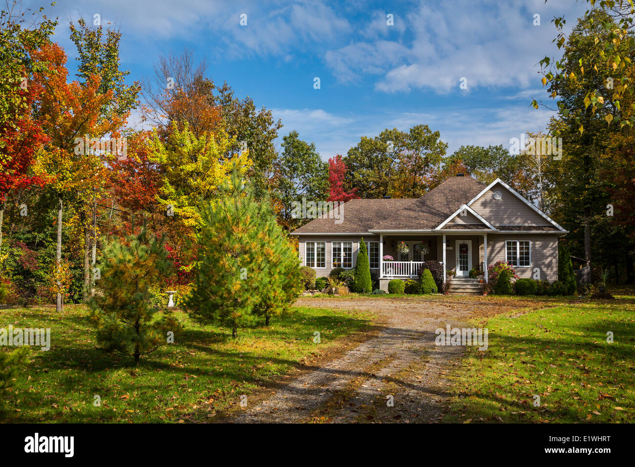 A rural quebec home in the countryside with fall foliage for Home wallpaper canada