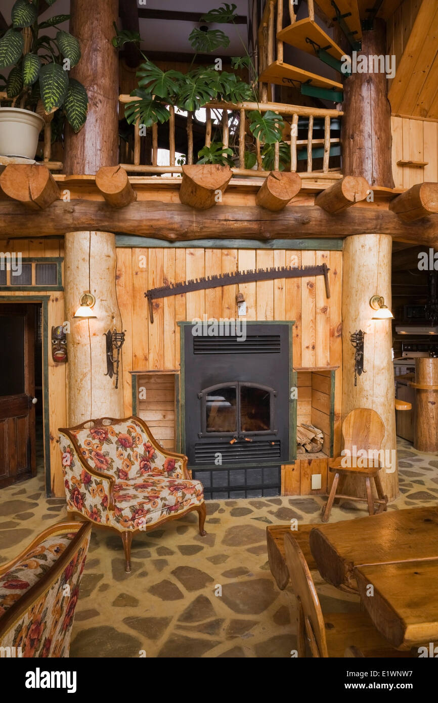 fireplace in the living dining room area inside a rustic cottage stock