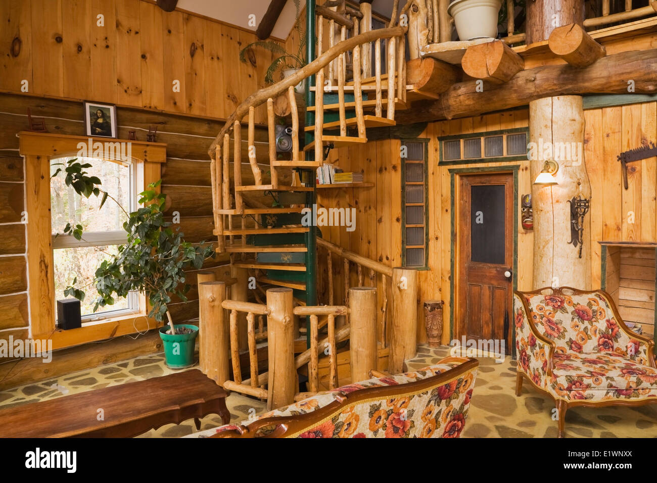 Spiral Shaped Staircase In The Living Room Inside A Rustic Cottage Style  Residential Log Home Quebec Canada. This Image Is