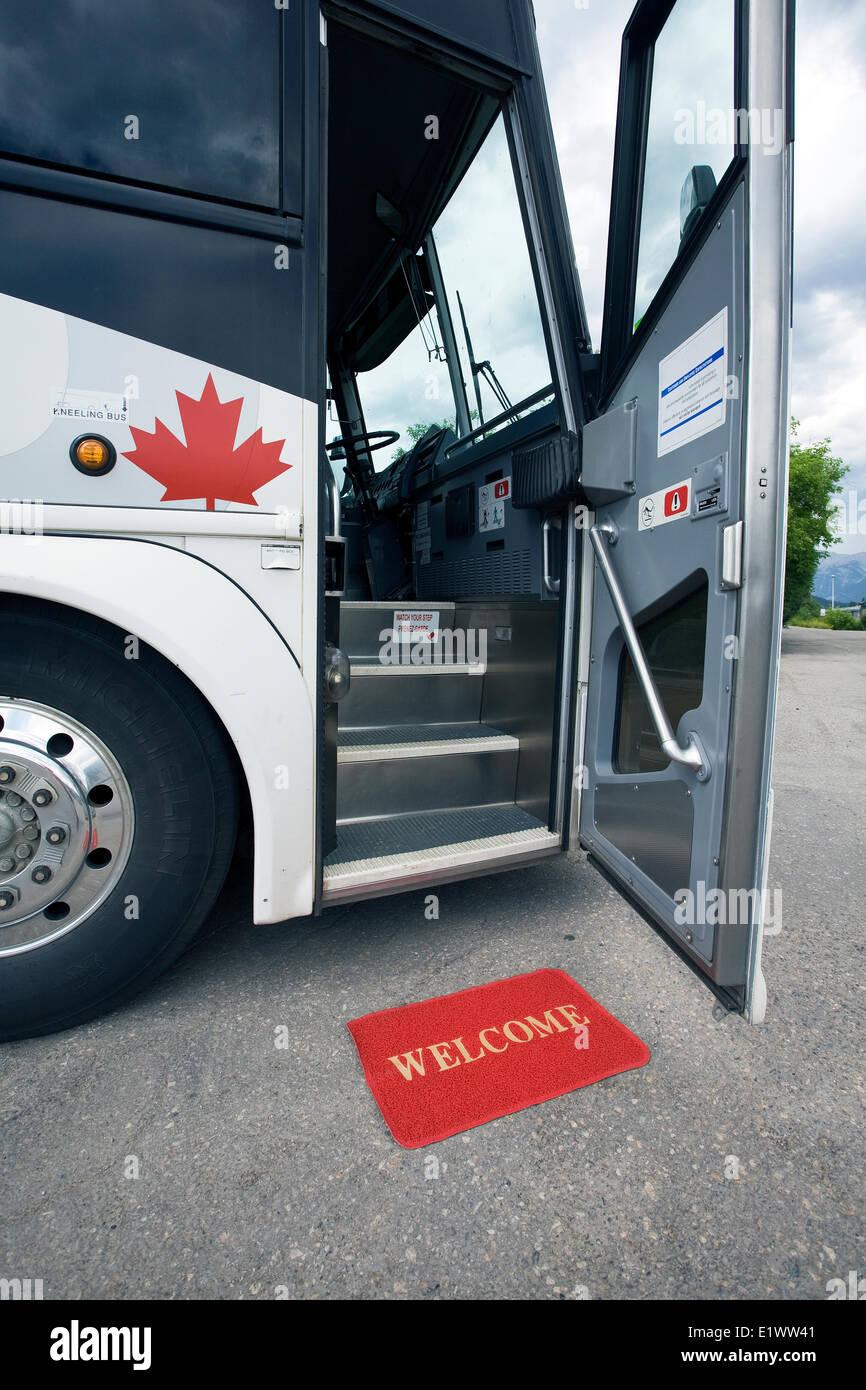 Stock Photo - Greyhound bus with open door and welcome matOpen Door Welcome Mat