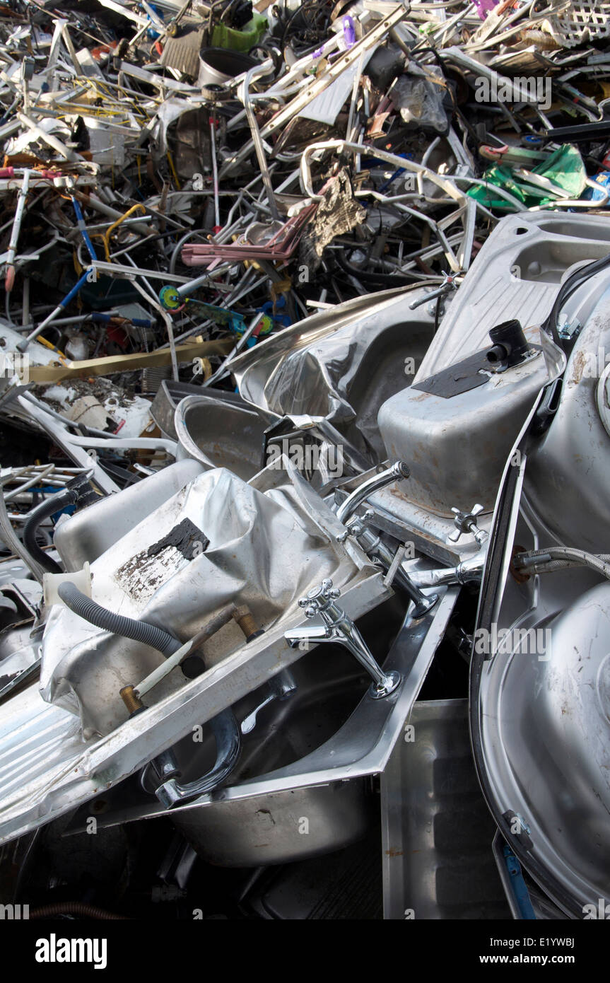 Reclaimed metals. Piles of household scrap metal for recycling ...