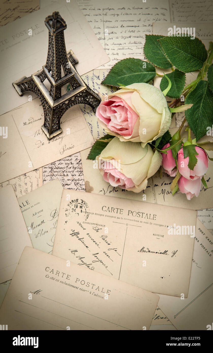 roses, antique french postcards and souvenir Eiffel Tower ...