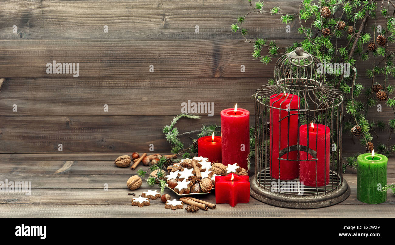 Stock Photo   Christmas Decoration With Red Candles, Birdcage And Pine  Branch. Vintage Style Home Interior. Cinnamon Cookies, Nuts And Spieces