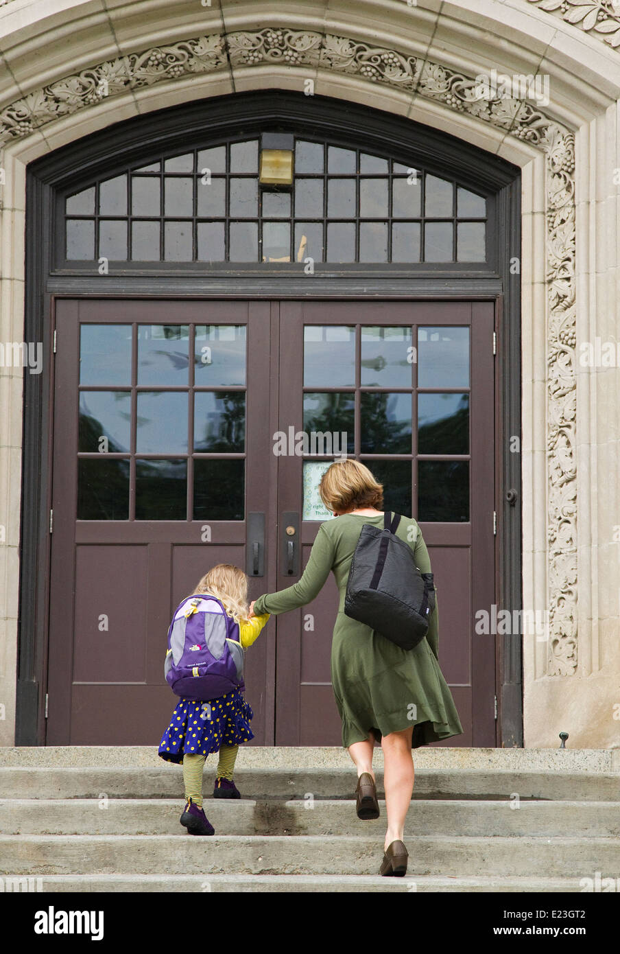 Mother and daughter walk up stairs to double doors & Mother and daughter walk up stairs to double doors Stock Photo ...