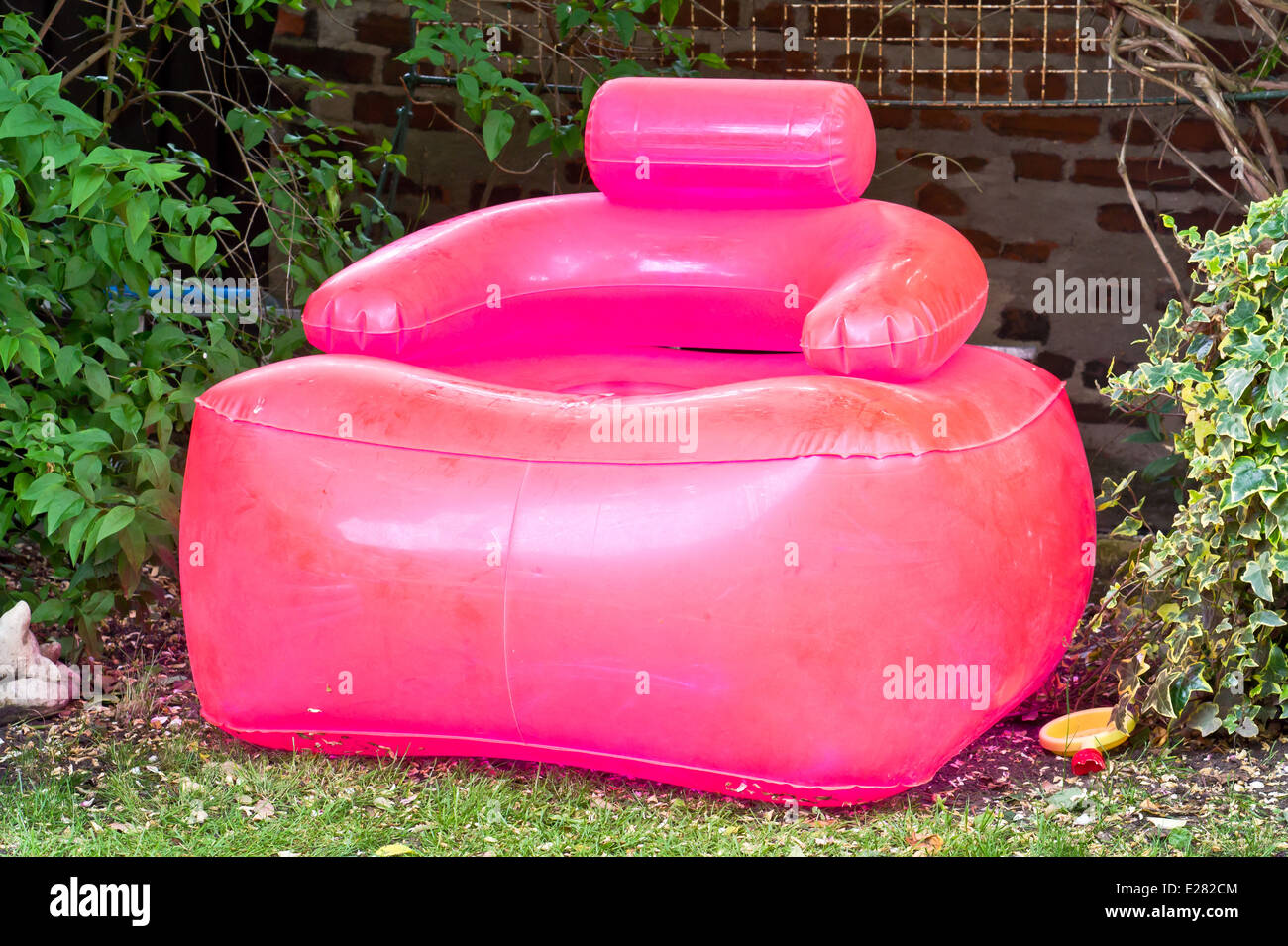 inflatable garden furniture. a pink inflatable chair in garden furniture