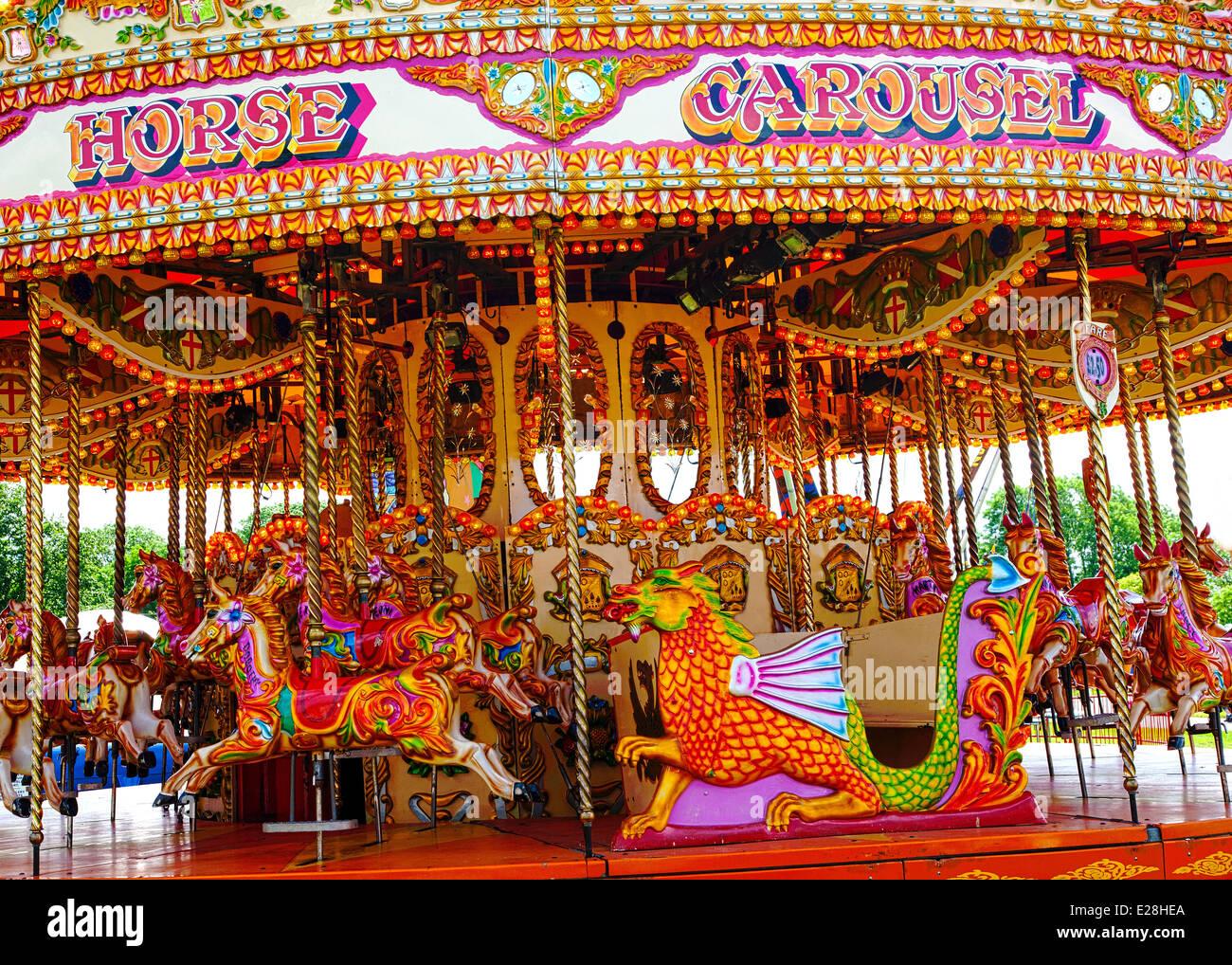 Old fashioned carousel fun fair ride Stock Photo: 70260130 - Alamy