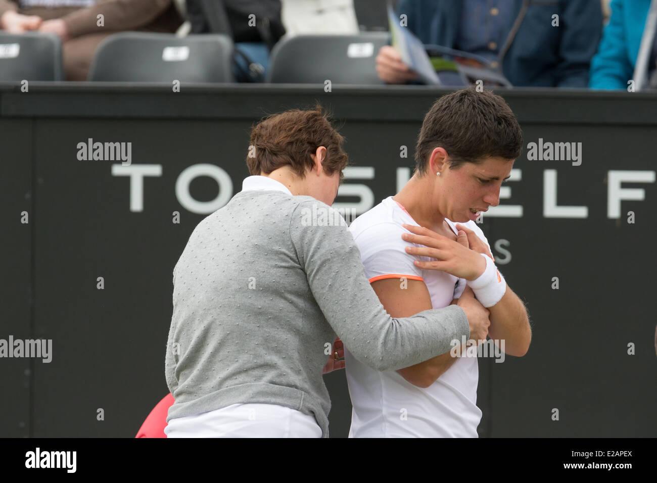 Tennis player carla suarez navarro esp receives a medical treatment during her 2nd round