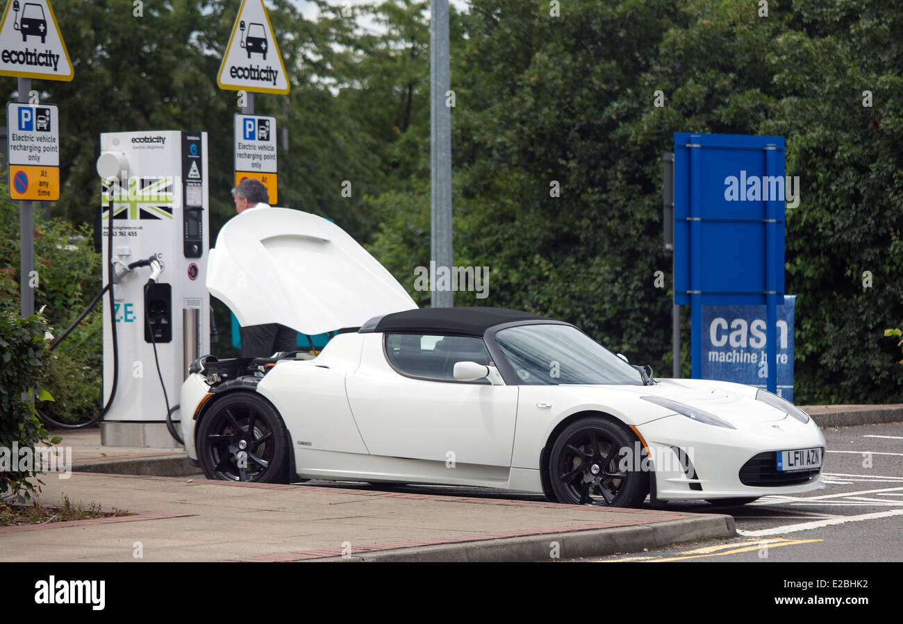 Tesla Roadster Electric Car Supercar On Charge At Heston Services
