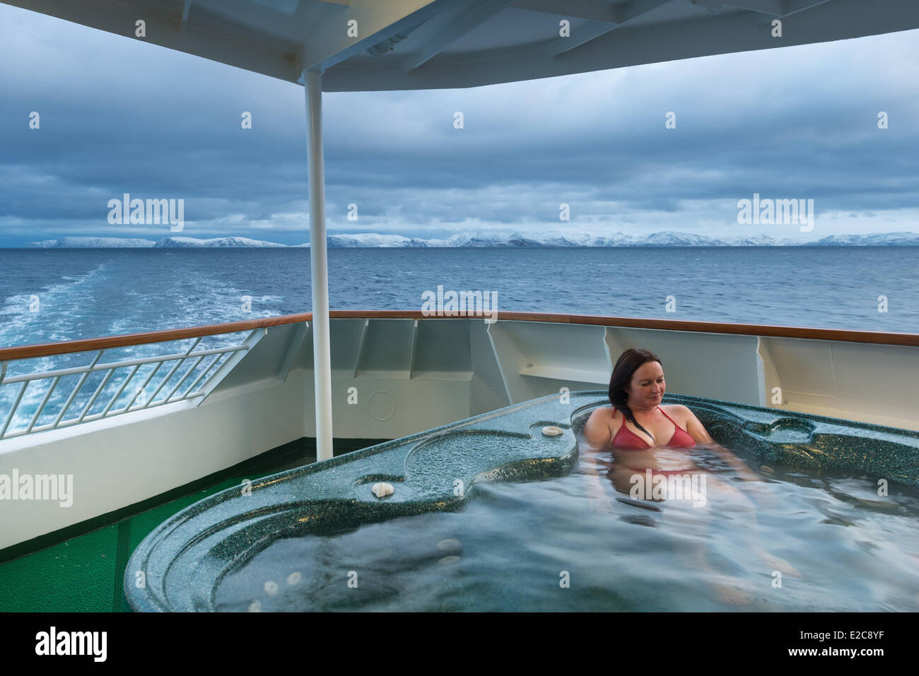 Norway, Finnmark, Hammerfest, tourist in the jacuzzi of the ship ...