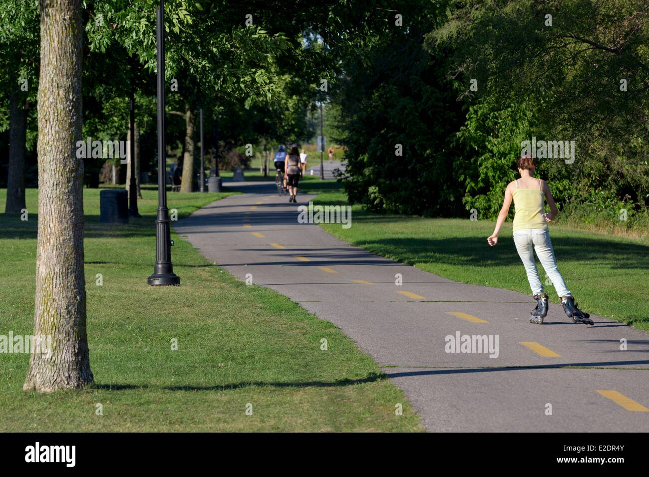 Roller skating montreal - Canada Quebec Province Montreal Verdun Disrict The Bike Path Along The St Lawrence River Woman On Roller Skates