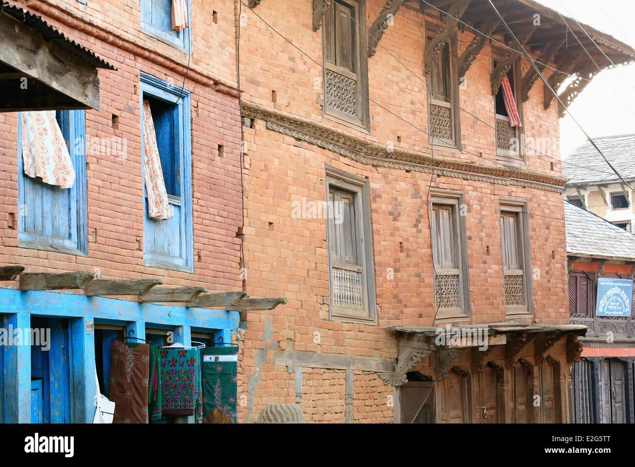 Red brick facades of traditional newari style houses with for Window design in nepal
