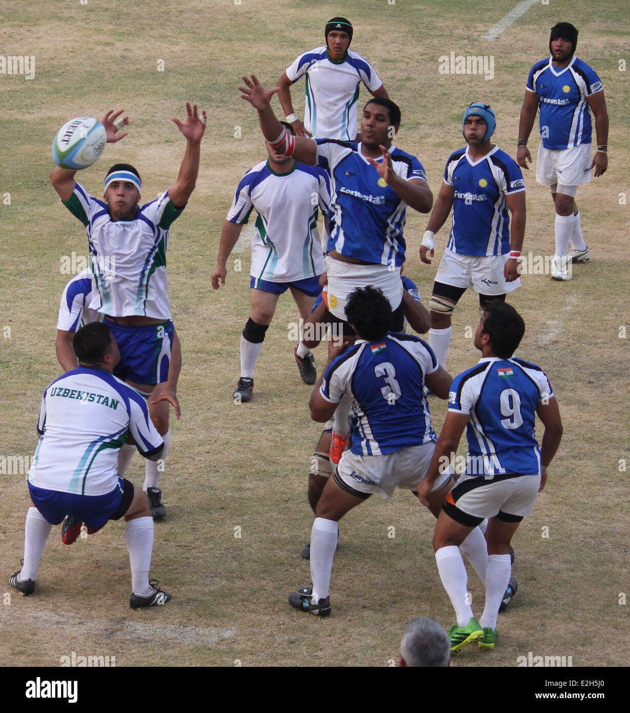 Indian Rugby Players (blue Shirt) Fight For The Ball With