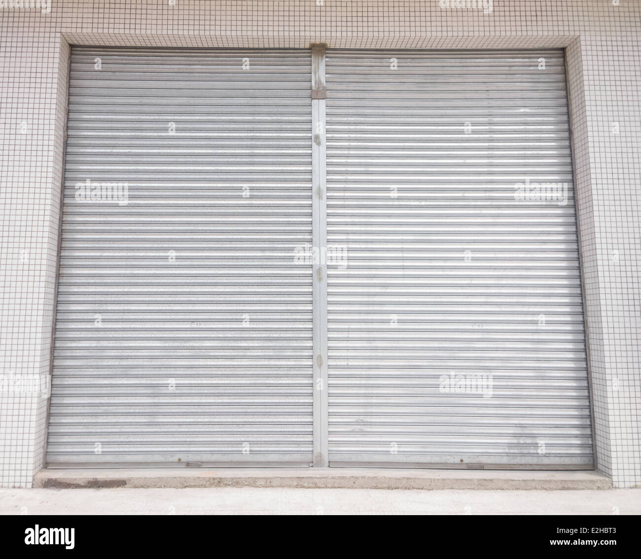 blank metal shutter doors on commercial shop front Stock Photo ...