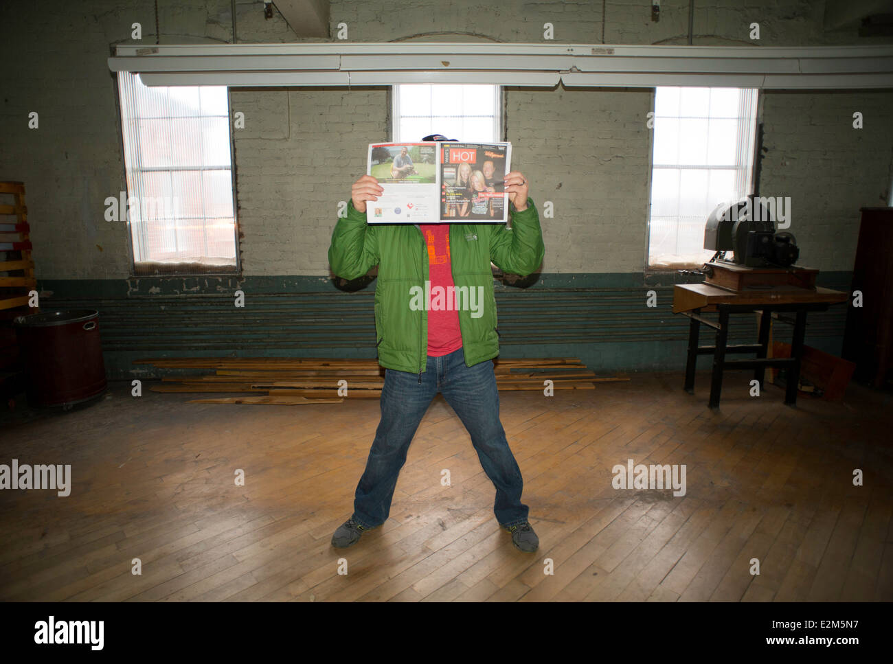 A 40-year-old man wearing a green jacket, red shirt, and jeans ...