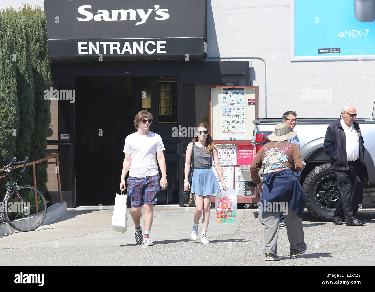Emma Roberts and her boyfriend, Evan Peters leaving Samy's Camera ...
