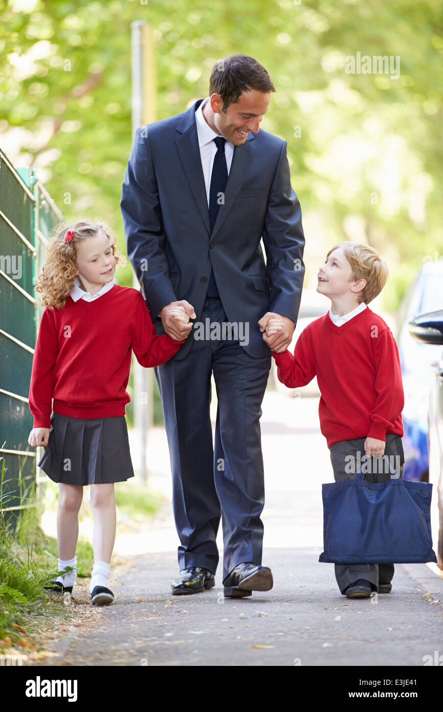 father walking to school children on way to work stock photo father walking to school children on way to work