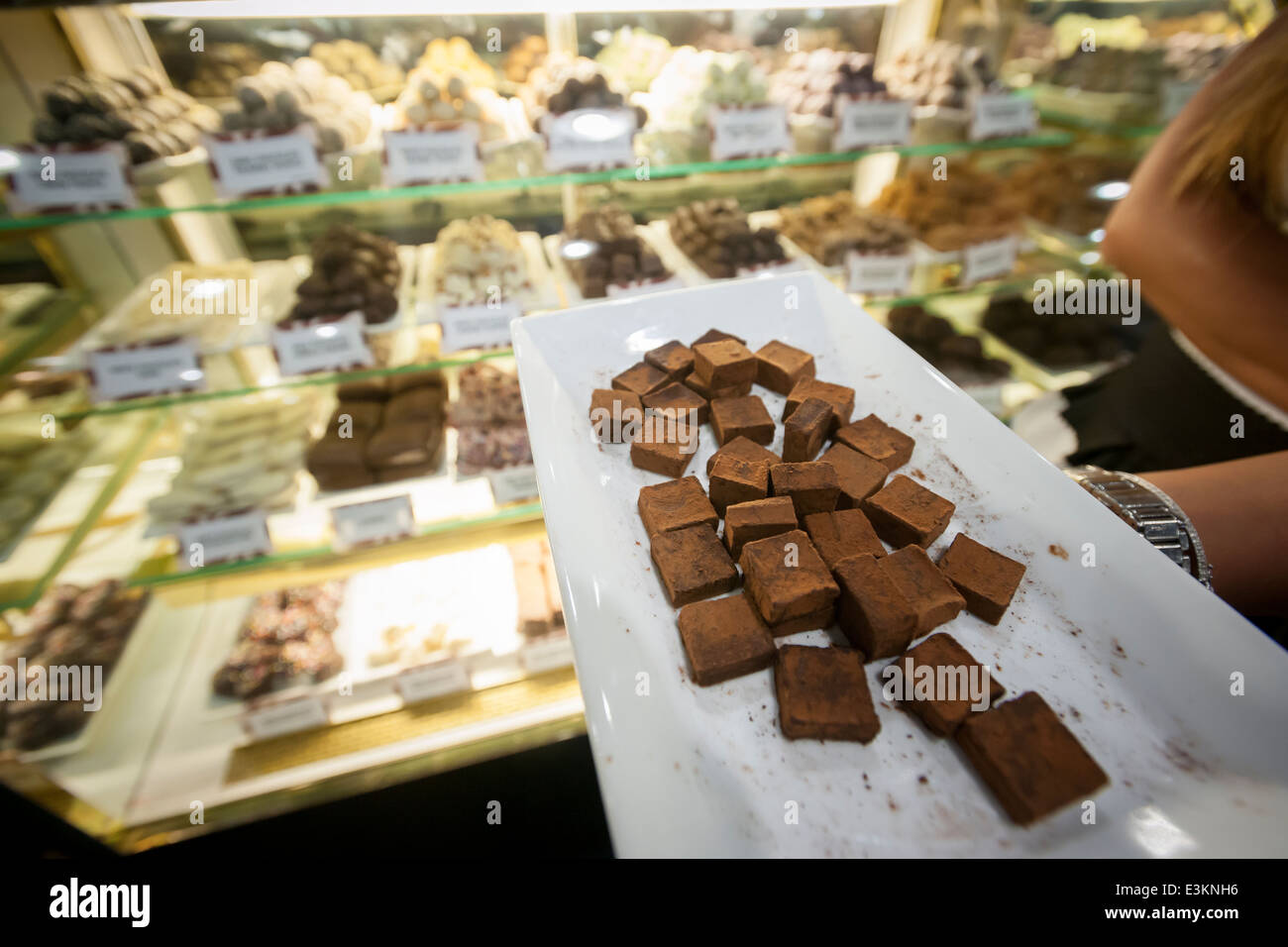 An exhibitor hands out samples of the Chocolate Works chocolate ...