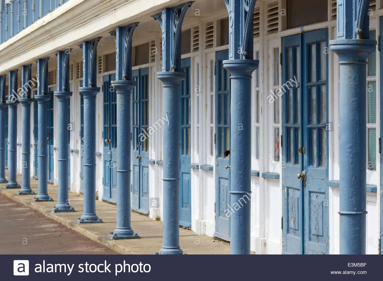 White Metal Pillars : View of the disrepairs metal pillars and doors