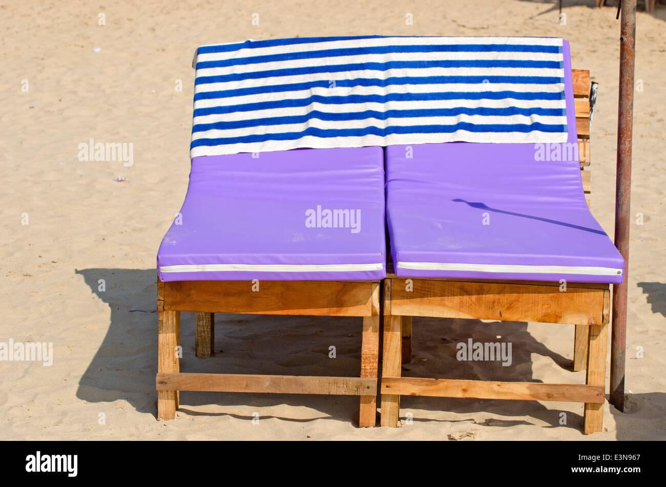 Relaxing sofas seats on beach sand, Goa, India Stock Photo ...
