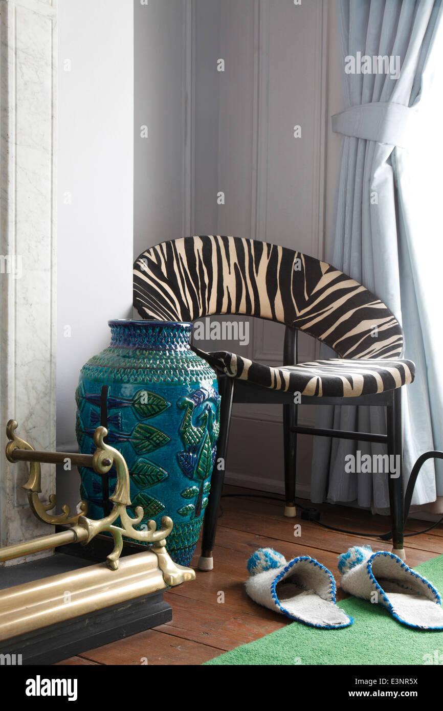 Zebra pattern circular 20th century chair in corner of bedroom zebra pattern circular 20th century chair in corner of bedroom with large blue ceramic vase next to brass fire surround reviewsmspy