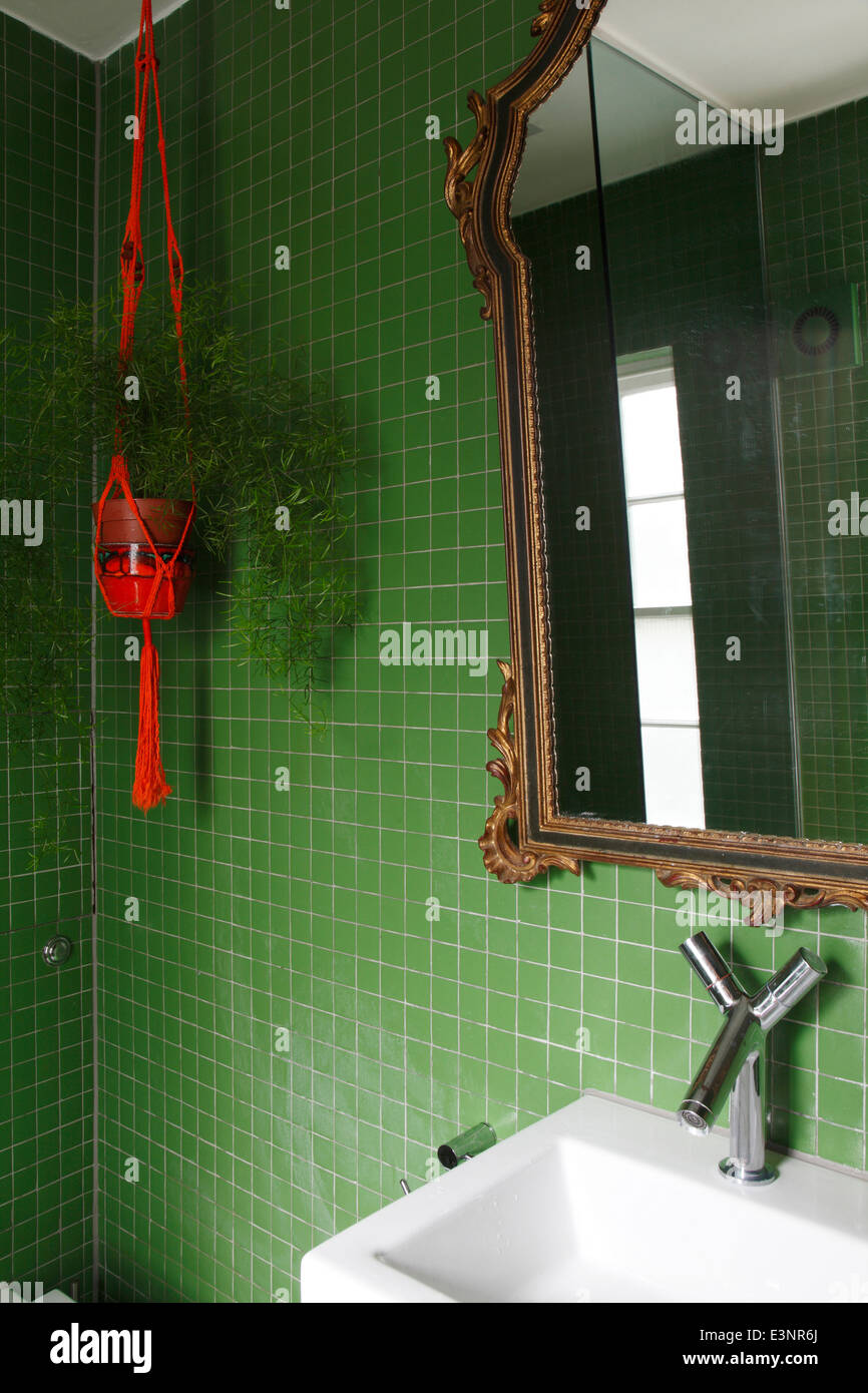 Small bathroom with emerald green square tiles gilt framed mirror small bathroom with emerald green square tiles gilt framed mirror and red ceramic and rope plant holder dailygadgetfo Images