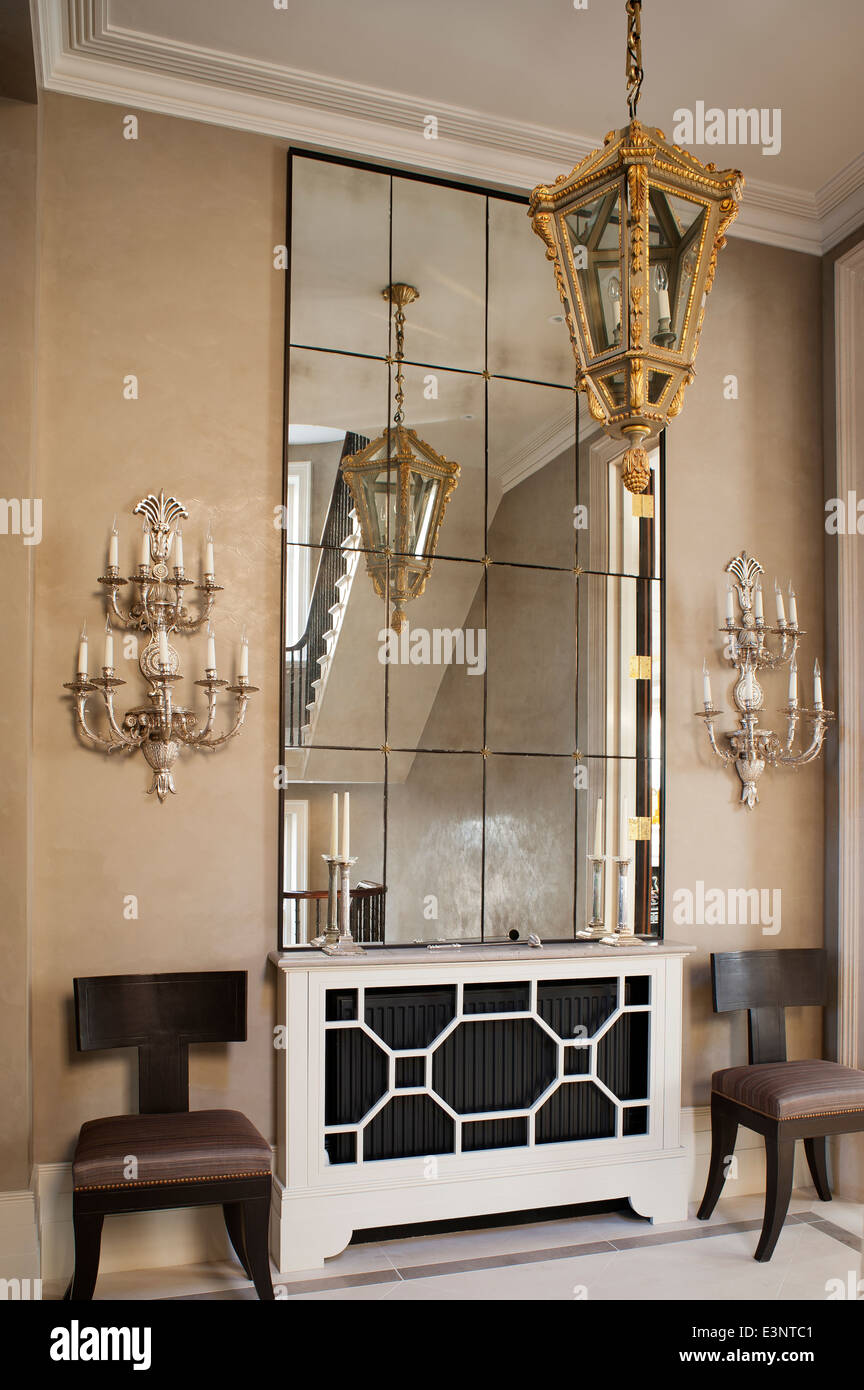 Mirrored Wall Panels decorative wall lights flank large mirrored wall panel in entrance
