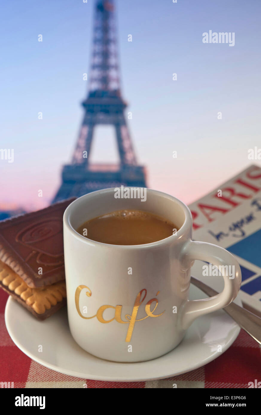 Outdoor cafe in paris with tower in background - Coffee And Biscuits On Cafe Table And Tourist Guide Book With Eiffel Tower In Background Paris