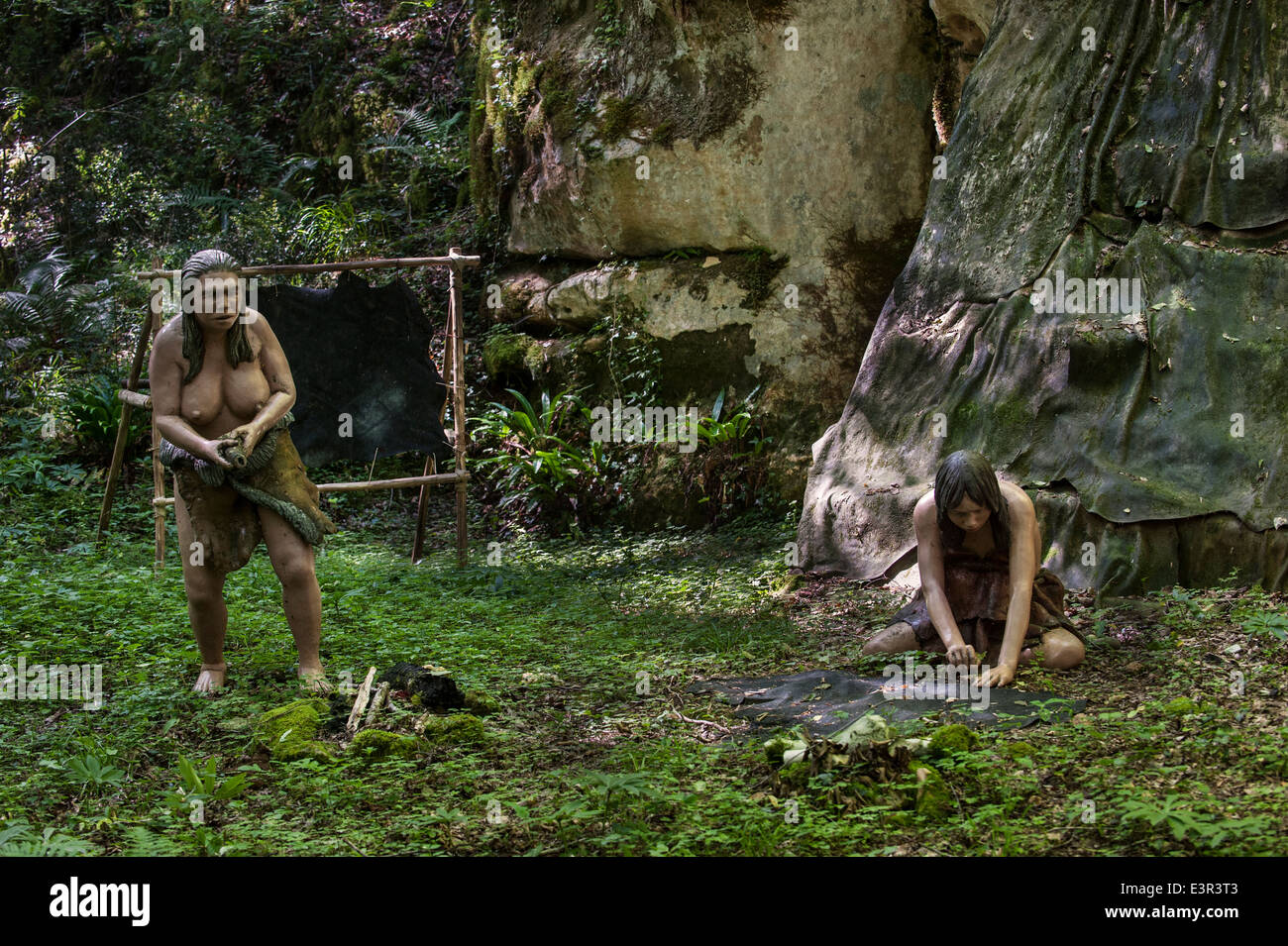 Neanderthal women working at open air dwelling with shelter ...
