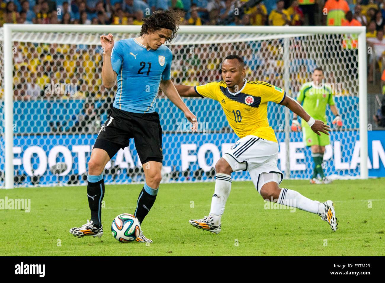 Edinson Cavani URU Juan Zuniga COL JUNE 28 2014 Football