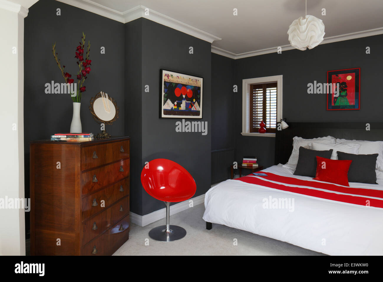 Red  white and grey colour scheme in modern bedroom  Brighton  Sussex. Red  white and grey colour scheme in modern bedroom  Brighton
