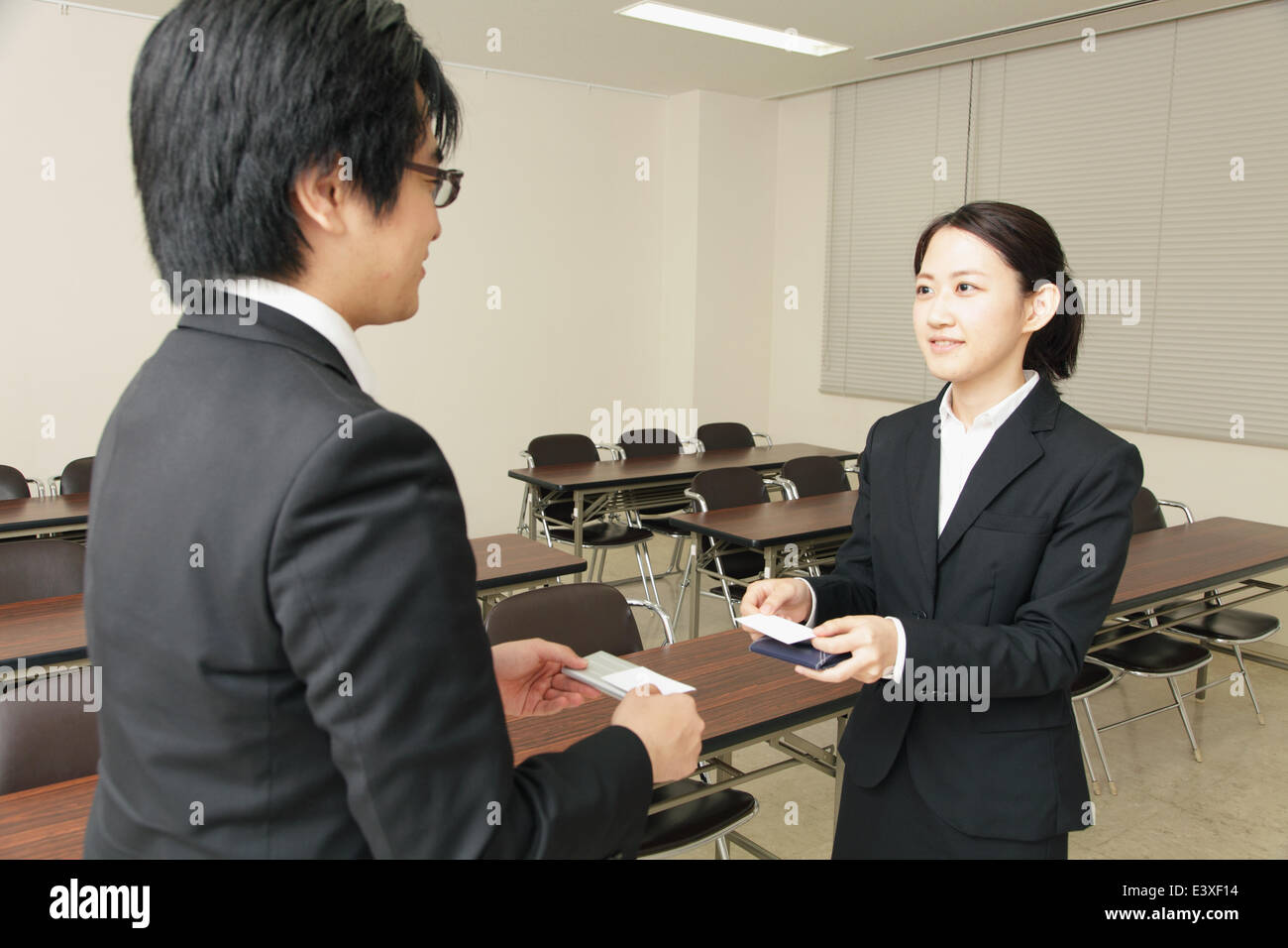 japanese business people exchanging business cards stock photo