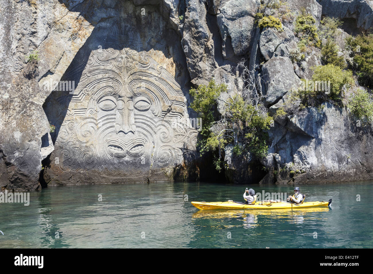 New zealand view to maori cave art with two tourists in