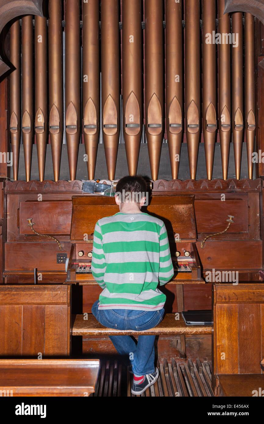 A 14 Year Old Boy Playing Pipe Organ Inside UK Church