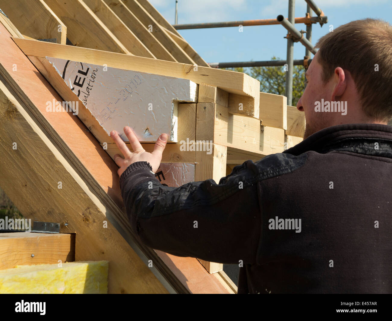 Stock Photo   Self Building House, Constructing Roof, Insulating Dormer  Cheeks With Sheet Insulation