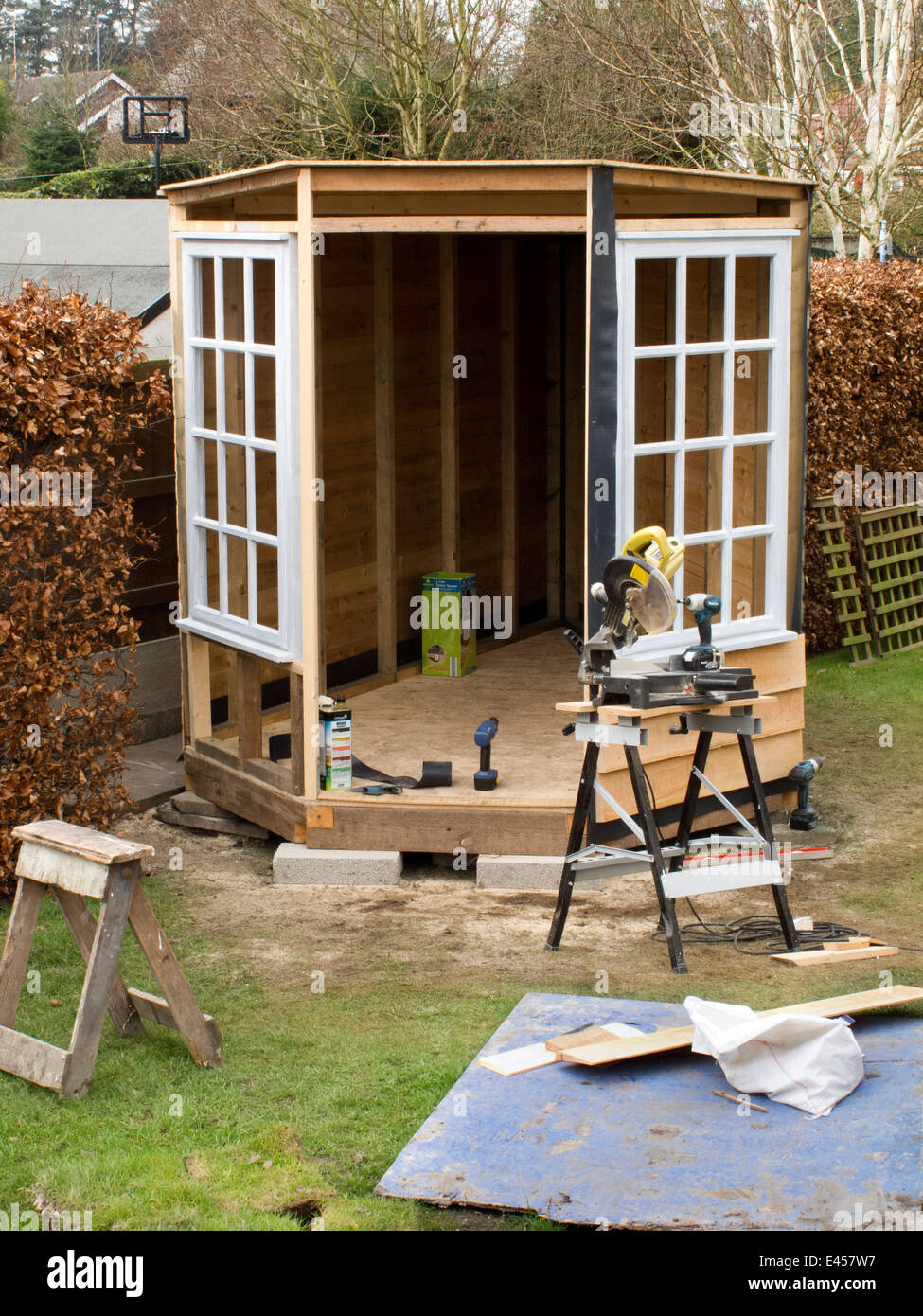 stock photo self building shed constructing garden shed with wooden frame and oak feather board round large windows - Garden Sheds With Windows