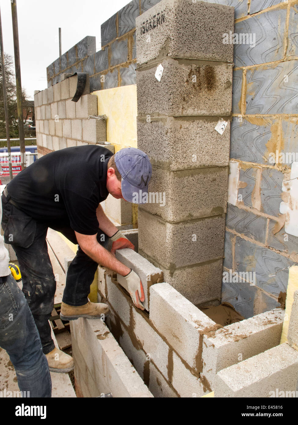 Self Building House Bricklayers Laying Concrete Block