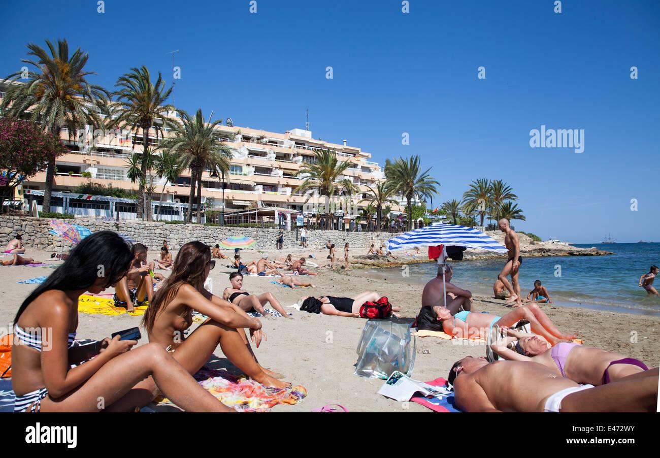 People On Figueretas Beach In Ibiza Spain
