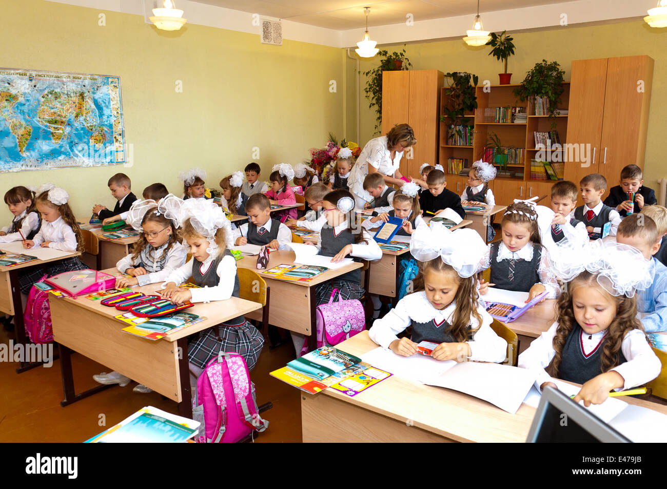 Pictures Of Elementary Classrooms ~ Elementary school students at classroom desks and their