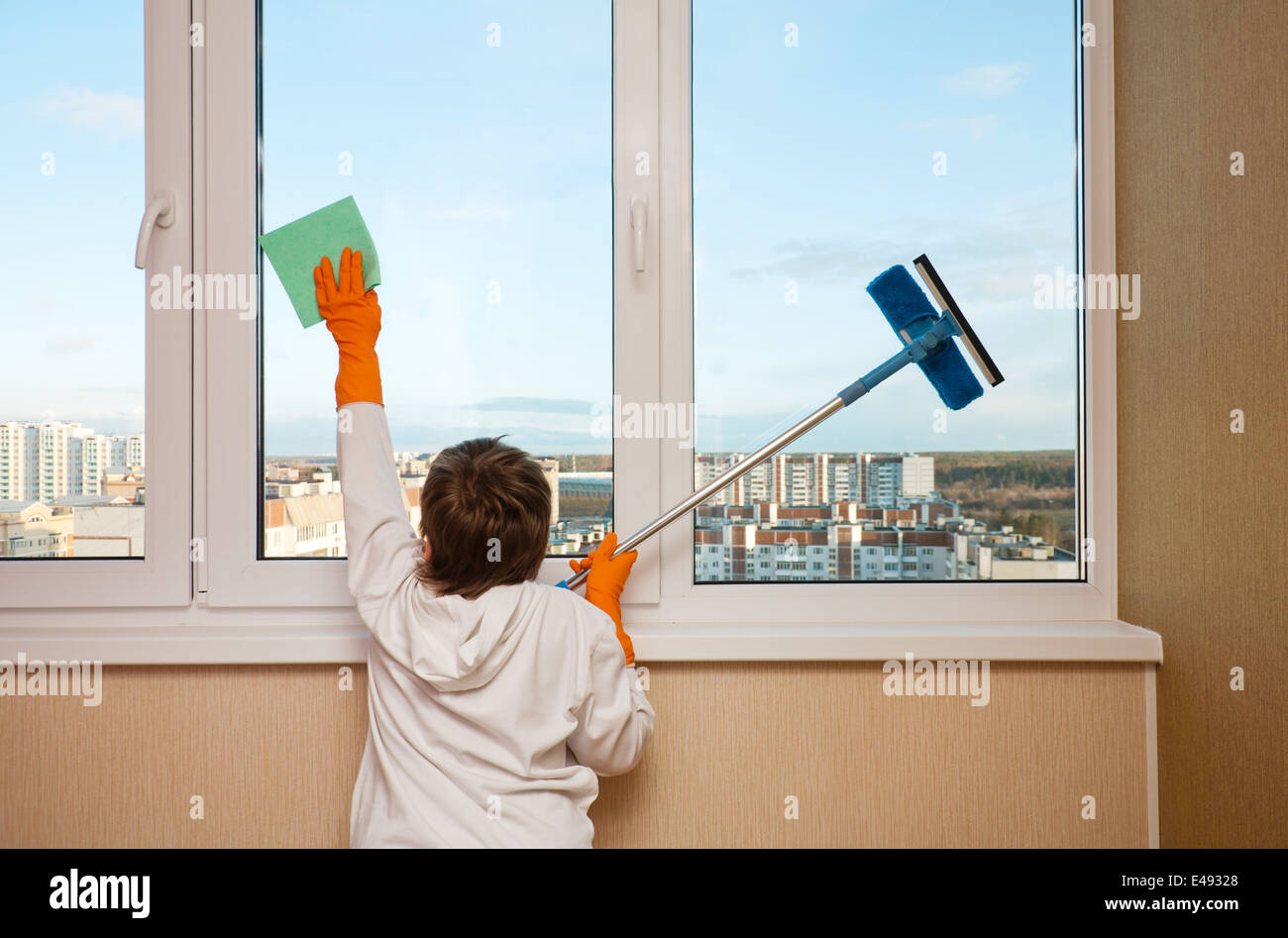 How to clean house windows - Stock Photo Boy Child One Wash Window Rag Gloves Household Work Help Helper 9 Year Flat House Home Clean Cleaning Cleans Cleaned General Cau
