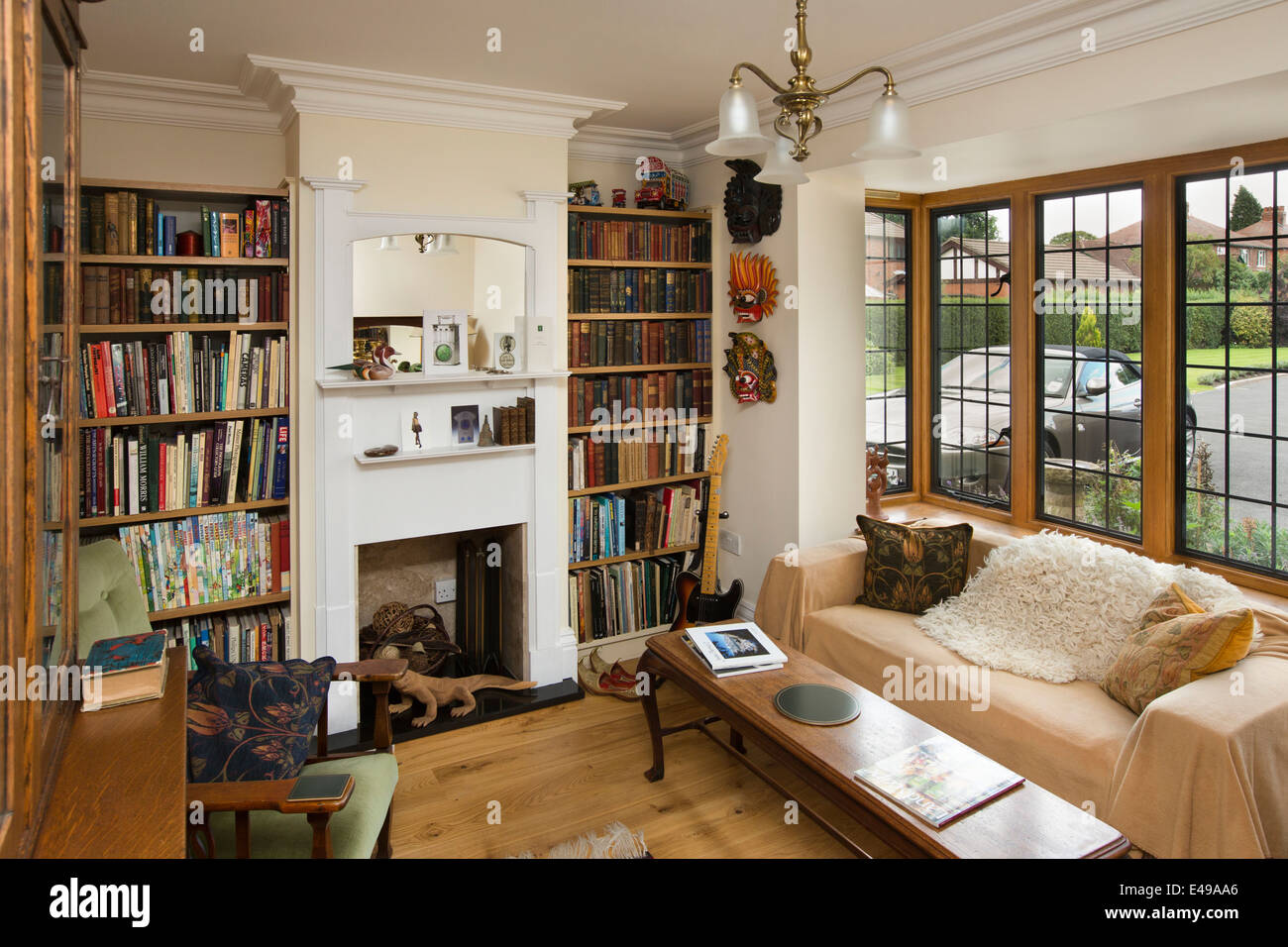 stock photo house interiors small snug with bookshelves of self built house designed on arts and crafts design principles - Self Home Design