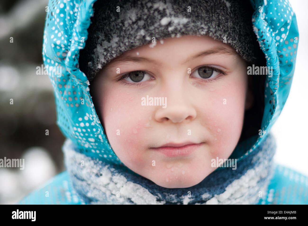 portrait boy child 7 8 9 year winter snow wet drops jacket ...