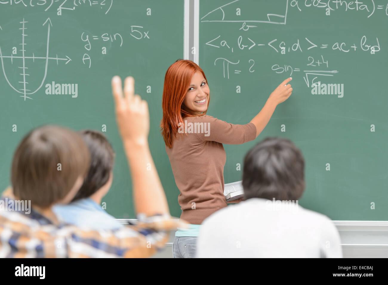 math-lesson-student-write-on-green-chalk