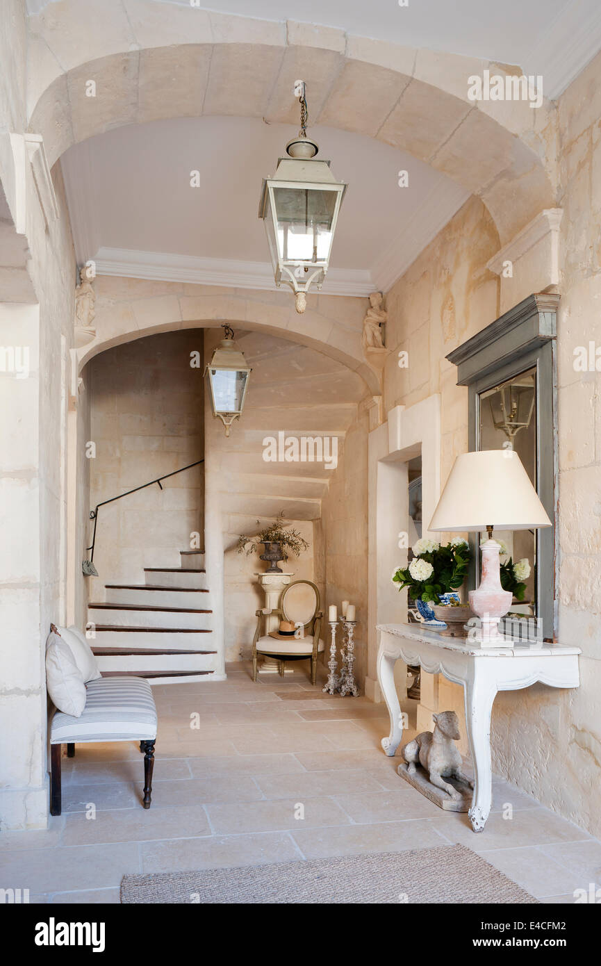 Entrance Hall In 18th Century Provencal House With Stone Staircase And Antique Two Legged Wooden Console